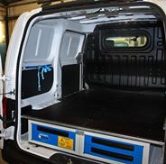 Cargo retaining straps in an NV200 fitted out by Syncro North America