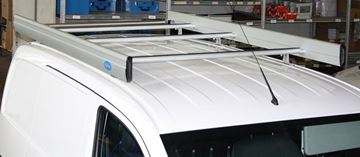 A Syncro roof rack with loading roller and side fences on a NV200