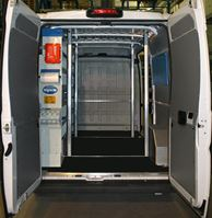 01_A van racking system for carrying and installing doors and windows