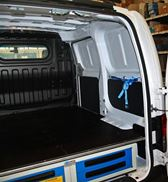 A raised-floor storage system by Syncro System in an NV200